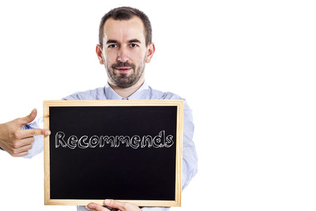 73194524 - recommends - young businessman with blackboard - isolated on white - horizontal image